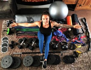 Amy with workout equipment